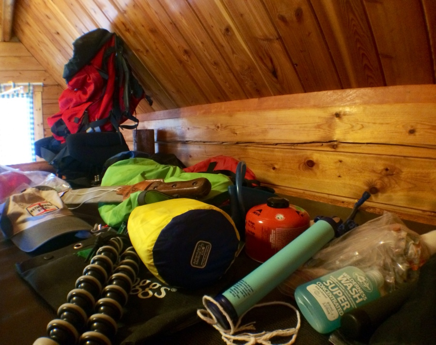 Gear and empty backpack before the walk. Bunkhouse. North Dakota.